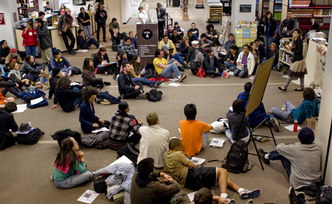 City College students sit in protest reduced library hours and other cuts to student services Feb. 11 on the 4th floor of Rosenberg Library. About 100 students occupied the library and stayed past the new 6:45 p.m. closing time during the study-in. DON CLYDE / THE GUARDSMAN