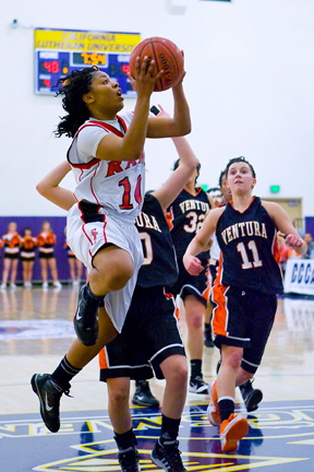 Sophomore guard Brittney Allen goes for a layup against Ventura defenders. Allen scored 25 points against Ventura, leading all scorers. PHOTO COURTESY OF ERIC SUN.