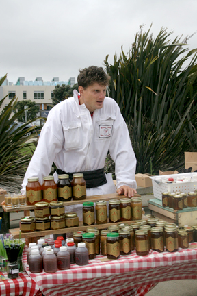 Rokas Armonas sells honey from Marshall's Farm at Ram Plaza on April 19. JOSEPH PHILLIPS / THE GUARDSMAN