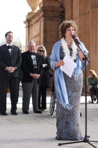 Campaign Chair for the Palace of Fine Arts Donna Huggins addresses gatherers at a ceremonial grand reopening of the newly renovated landmark.