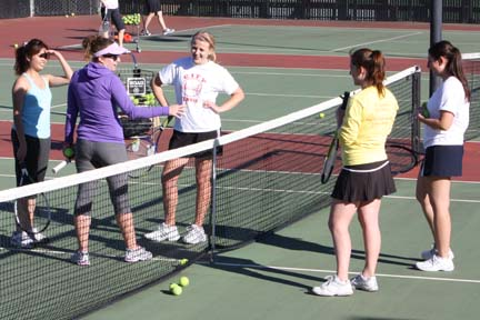 Women's tennis head coach Kelly Hickey gives her team instruction during a Jan. 20 practice.