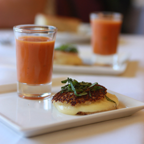 JESSICA NORTH/THE GUARDSMAN An amuze bouche of a petite fontina and mozzarella grilled cheese finger sandwich is served with a tomato soup shooter to stimulate the taste buds before the meal.