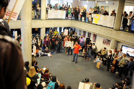 Felix Cabrera, City College Associated Students vice president of cultural affairs, speaks about SF State and City College's connection to a crowd approximately 500 people in SF State's Cesar Chavez Student Center on March 2. Cabrera addressed the group moments before demonstrators marched to City College's Ocean campus to show unity between the schools. PHOTO BY RAMSEY EL-QARE / THE GUARDSMAN