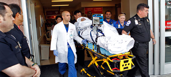 Neurosurgeon Dr. Gabriel Zada, left, Los Angeles County-University of Southern California medical team and air and ground transport team move Bryan Stow, a paramedic who suffered brain damage in an attack on opening day of the Dodgers game in Los Angeles, to a waiting ambulance at the Emergency Room Ambulance entrance on Monday morning May 16, 2011. Stow will be flown from Burbank, Claifornia, to San Francisco. (Al Seib/Los Angeles Times/MCT)