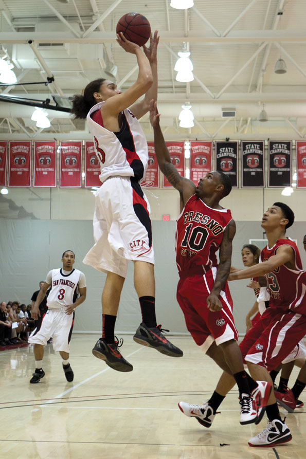 Garrett Moon #33 attempts a mid range jumper over Fresno City College's Erwin Thomas Hammock #10 on Nov. 11, 2011. STEPHEN HERALDO / THE GUARDSMAN