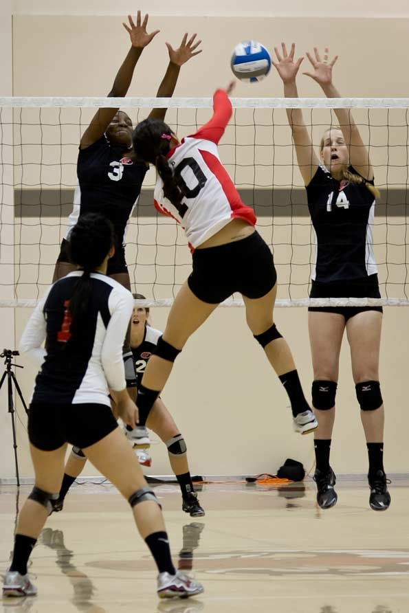 Nicole Yap (10) elevates and drills the ball to split Foothill's Motade Atanda (3) and Kelsey Moore (14). Yap finished the game with an impressive 18 kills, 27 digs, 3 aces, and 1 block. STEPHEN HERALDO / THE GUARDSMAN