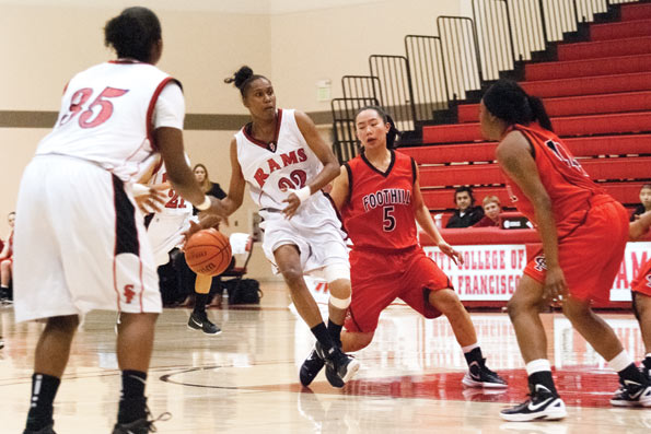Ram's sophomore Janis Peterson #32 leads the ball down the court during a game against Foothill College on Jan. 13, 2012 at the City College Ocean Campus in San Francisco. The Rams won the game with a 61-58 final score. CLARIVEL FONG / THE GUARDSMAN