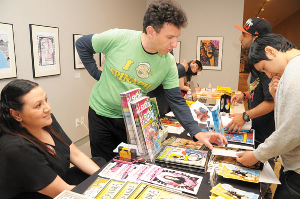 "Grasiela Rodriguez author of ""Lunatic Fringe"" and ""Sprada"" and Michael Aushenker author of ""El Gato, Crime Mangler"" series speak with attendees at La Raza Comica: Latino-American comic arts exhibition at the Cartoon Art Museum on May 05, 2012. Michael Aushenker is the author of the ""El Gato: Crime Mangler"" series. He has also wrote the current issue of Matt Groening's ""Bart Simpson"" comics, #70, now on sale at newsstands and book shops. SHANE MENEZ / THE GUARDSMAN"
