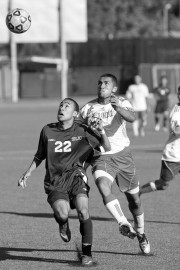Santa Rosa Junior College Freshman forward Carlos Pecanha (22), and City College Sophomore defender Edwin Garcia (4),