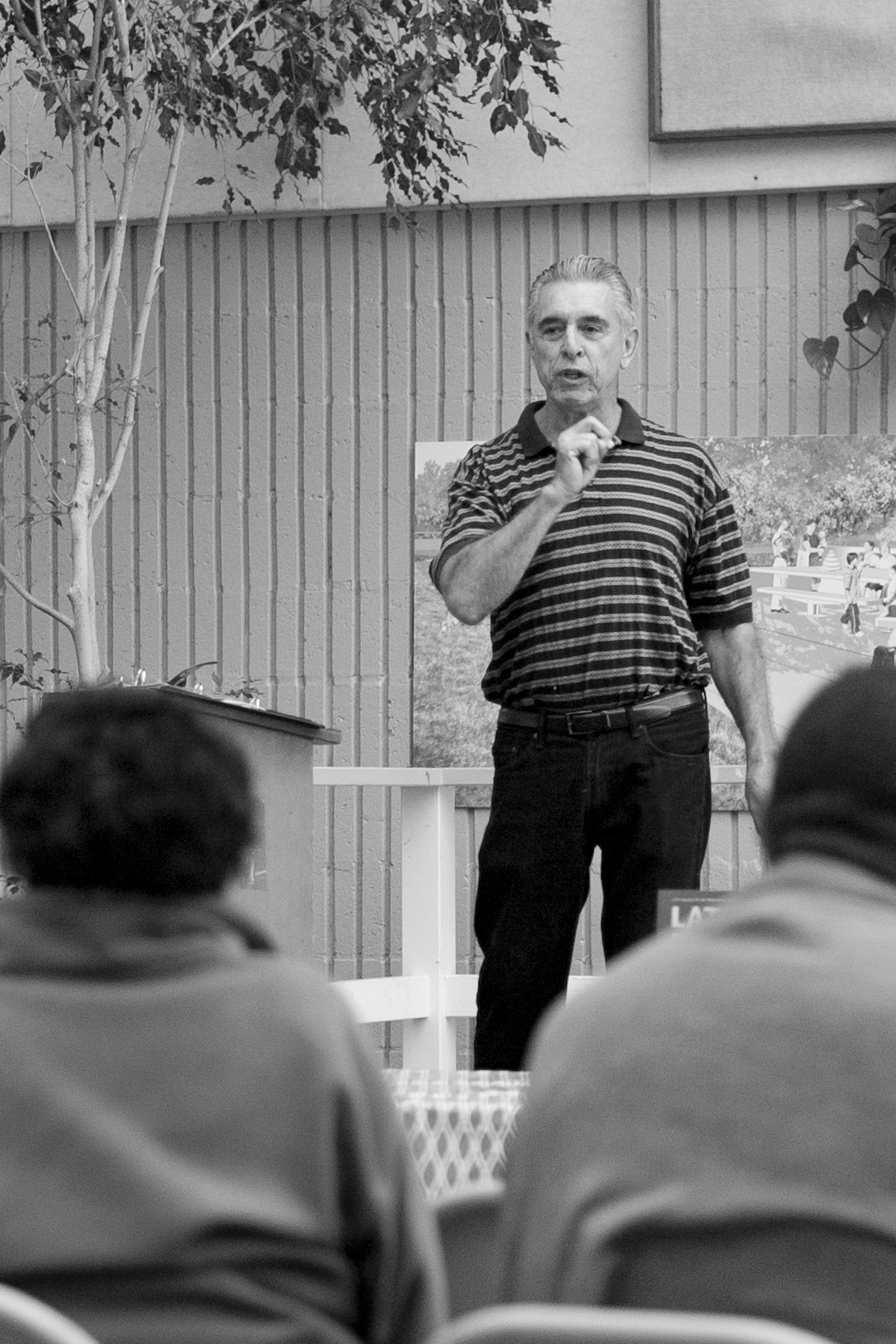 William Maynez, coordinator of The Diego Rivera Mural Project and former City College physics lab manager speaks about Diego Rivera and his wife Frida Kahlo, during a slideshow presentation recognizing Latina/Latino Heritage Month (Sept. 15 - Oct. 15) at City College's South East Campus on Tuesday, Sept. 25. Maynez compared/contrasted the works of Rivera and Kahlo, and identified social issues represented within their art. Photo by James Fanucchi/The Guardsman.