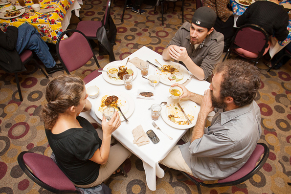 Counterclockwise from left: Emily Beitiks, Mike Beitiks, and Stephan Kolsanoff, enjoy a meal together at the, A Taste of Oaxaca 2012 fundraiser at the Pierre Coste Room restaurant at Ocean campus on Oct. 5, 2012. Culinary student Bernadette Ramos invited them to sample Oaxacan inspired dishes such garlic soup, negro molé and verde molé, each are made from over 20 ingredients. Photo by Wez Ireland/The Guardsman