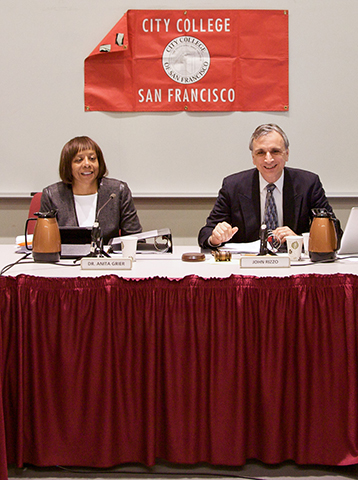 Dr. Anita Grier, Vice President of the Board of Trustees(left) and John Rizzo, President of the Board of Trustees(right) share a smile with the members of the board before the long and stressful meeting that took place on Thursday Jan. 24, 2013. Photo by Juan Pardo/The Guardsman.