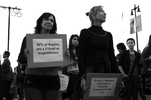 Beth Marer-Garcia and Wendy Harrison hold a sign that depicts the fact of sexual assault in the United States in hope to wake up individuals across America. photo by Francesca Alati/The Guardsman