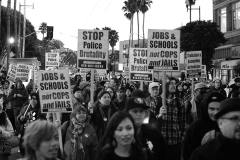 Demonstrators march down Mission street to protest the arrest of City College student Kevin Clark on Feb 7. Photo by Shane Menez / The Guardsman
