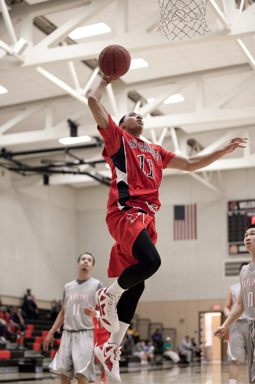 Ram's Quincy Smith (11) dunks the ball against the Trojans at Skyline College on Feb. 15. (Santiago Mejia / The Guardsman)