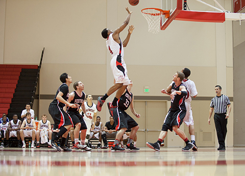 Rebound! Freshman Chuks Iroegbu attempts to tip the ball in after a missed three-point shot against Conference rival Foothill College on Friday Feb. 1 at the Ocean Campus.. Photo by Santiago Mejia/The Guardsman