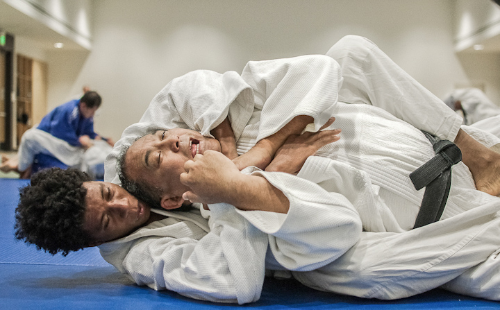 Deante Meitz (bottom) performs a choke on instructor Mitchell Palacio during the Advanced Jiu-Jitsu class in the Wellness Center on Feb. 14. Shane Menez / The Guardsman
