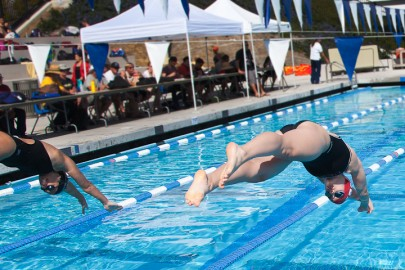 Ram's Haylei Plageman (right) begins her 200 yard freestyle race. Her final time was 2:14.87 on March 1, 2013 at the College of San Mateo. Photo by Juan Pardo / The Guardsman.