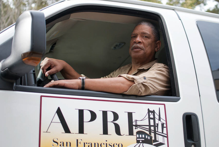 Eddie Kittrell, a shuttle driver for the A. Philip Randolph Institute of San Francisco, provides safe and secure transportation for students in the Bayview/Hunters Point area on March 15, 2013. Funding for the shuttle program was cut last semester, leaving students to seek other means of transportation. Photo by Sadie Farrington/The Guardsman