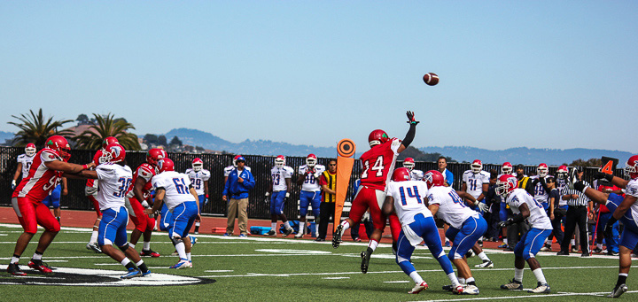 Defensive back, Dominique Cole (14), attempts to catch the football against West Hill Falcons on Saturday, September 15, 2012 in San Francisco, Calif. Photo By Leslie Calderon/The