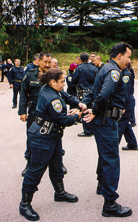 Officer Beatrice Ramirez, star #31 (left), engages in police training with SFPD in 1998. Photo courtesy of family