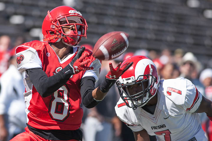 San Francisco Rams receiver Xavier Amey (8) attempts to catch a pass as he's defended by Fresno Rams Justice Sarcedo (7) on Saturday, Sept. 28, 2013, at Ocean campus. Photo by Santiago Mejia/The Guardsman