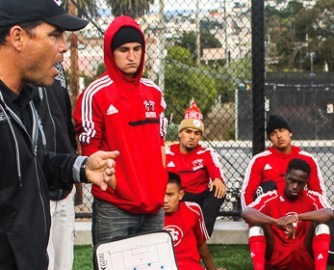 City College's men's soccer head coach Adam Lucarelli instructs his players during  halftime at the Rams' soccer field on Ocean campus Sept. 20, 2013. Photo by Lucas Almeida/The Guardsman