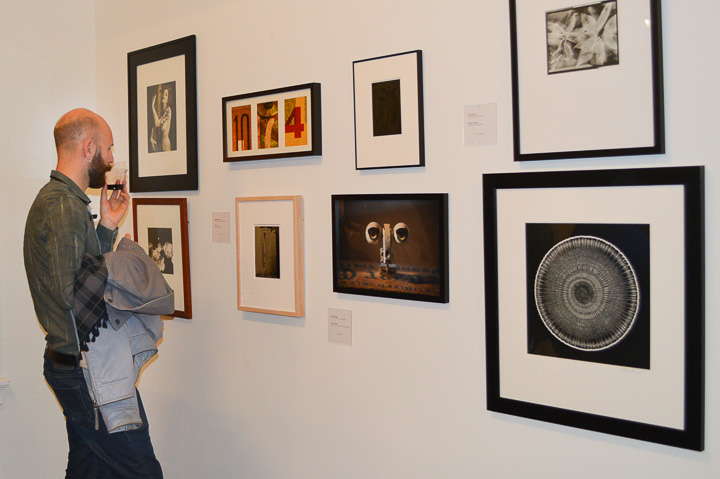 A man views a gallery during City College's 75th anniversary of its Photography  department showcase, Jan. 17, 2014, at SF Camerawork. Photo by Bridgid Skiba/The Guardsman