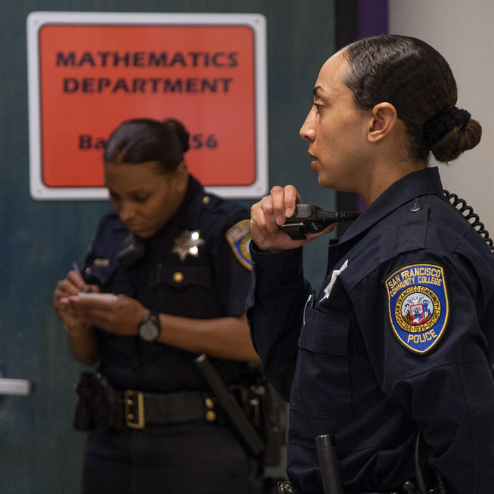 Officers Erica McGlaston and Tiffany Green report to Batmale Hall after receiving a call regarding a disruptive student, Thursday, Feb. 27, 2014, at Ocean campus. Photo by Santiago Mejia/The Guardsman