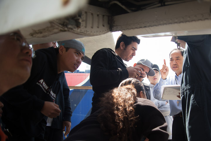 Instructor Hoi Ko, right, gives a lecture of the aircraft to his students.