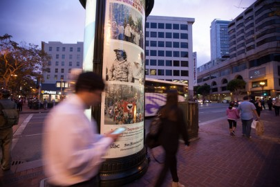 One of the 40 kiosks with poster-sized prints of selected images from the exhibit is located on Market Street at Powell Street and holds the work of Lou Demmatteis.