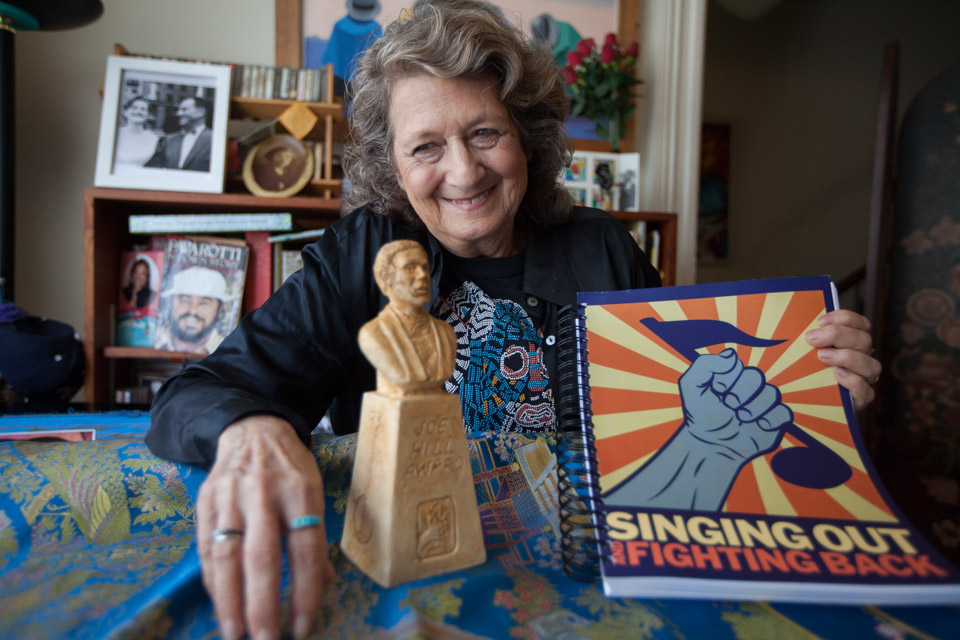 "Patricia Wynne poses for a photo Aug.11with her Joe Hill Award and new book entitled ""Singing Out and Fighting Back."" Photo by Nathaniel Y. Downes"