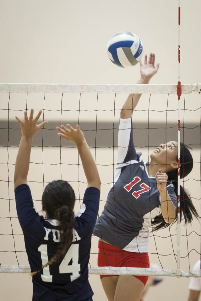Rams Brianna Caba (16) spikes the ball against Yuba College. (Photo by Santiago Mejia)