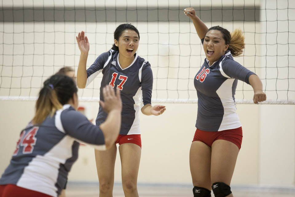 Rams Katie Kellie (17) and Brianna Caba (16) celebrate after scoring a point. (Photo by Santiago Mejia)