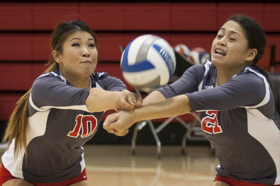 Rams Cynthia Lin (10) and Gaea Salazar (21) both dig at an incoming spike. (Photo by Santiago Mejia)