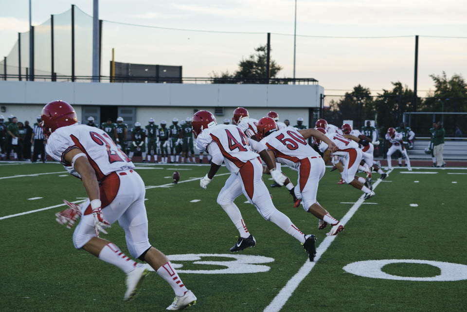Rams sprint down the field during kick off in a football game against the Laney College Eagles, Friday, Sept. 12, at Laney College in Oakland, California. (Photo by Yesica Prado/ Contributor)