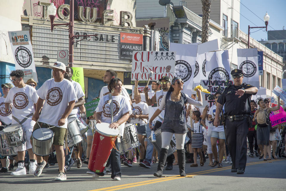 Demonstrators, in support of Prop. G, march to 16th and Mission Streets, Saturday, Oct. 4, 2014 ( Photo by Niko Plagakis)
