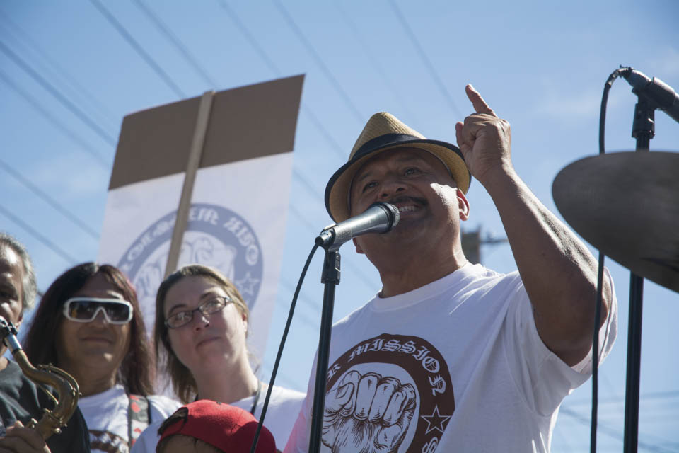 "Roberto Hernadez, resident of San Francisco Mission District, and community activist speaks to demonstrators about Prop G, that will be on the ballots in the upcoming elections. ""Prop G is our only hope to put a moratorium on evictions, stop the bleeding, and stop wiping out the Native San Franciscans."" He stated on Saturday Oct. 4, 2014,  in San Francisco, Calif. (Photo by Niko Plagakis)"