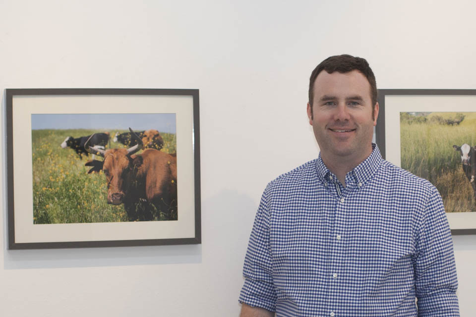 Brian Churchwell celebrates the opening reception of the Orinda Cattle exhibit on Oct. 8 at City College's Gallery Obscura. (Courtesy photo by Steven Churchwell)