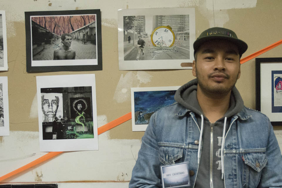 "Reynaldo R. Cayetano Jr. San Francisco local and head organizer of Inks of Truth, a San Francisco based collective of photographers and artists which include current and former CCSF students, shows his work in the space that used to be the old San Francisco Barber College, located at 64 6th Street, San Francisco.  ""We've been doing shows down here on 6th street since 2009, and this is our third time doing the art walk on 6th street,"" he explained on Friday, Oct. 10. (Photo By: Niko Plagakis)"