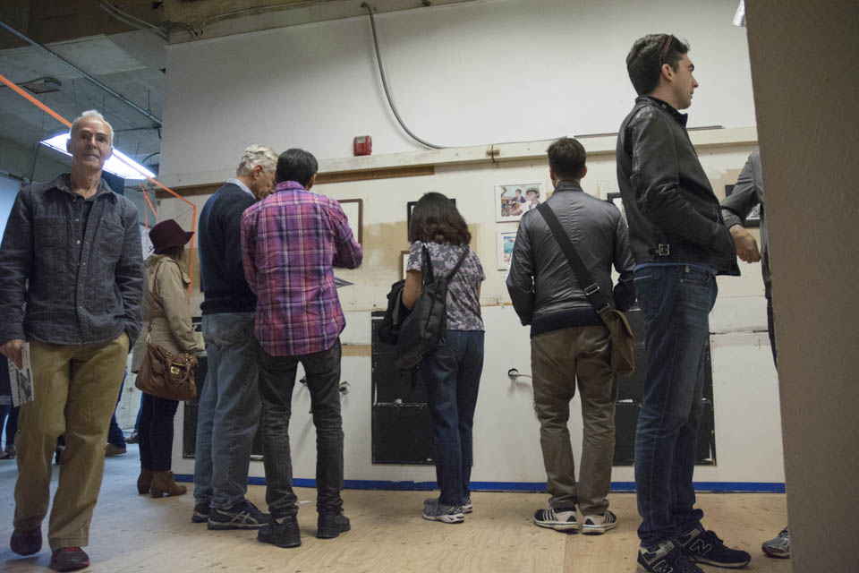 People gather to view works by Inks of truth at the San Francisco Barber College on 6th Street in San Francisco as part of the 2 Blocks Art Walk on Friday, Oct. 10. (Photo By: Niko Plagakis)