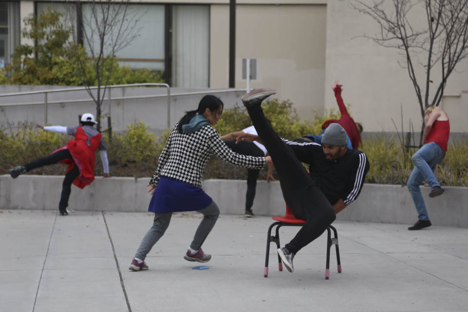 (L-R) Trolley Dancer Joyce Kushner and Franciscoo Arroliga rehearse in front of The Ocean Campus Wellness Center, Friday, Oct. 10. (Photo by Natasha Dangond)
