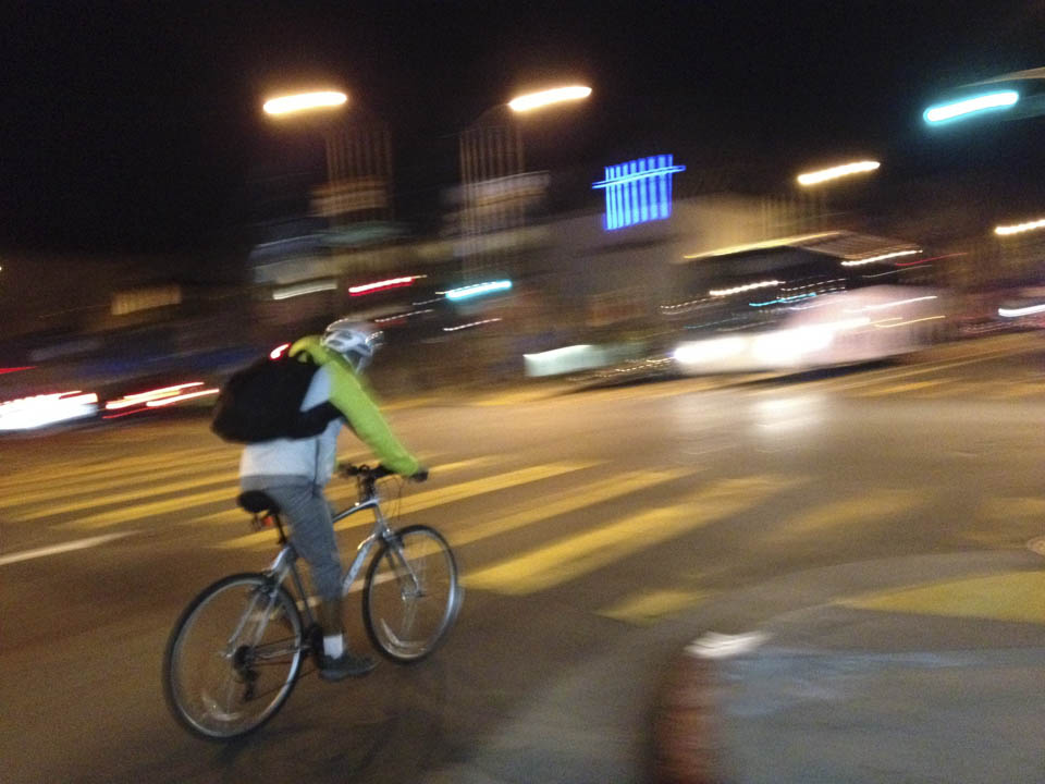 A man ride his bicycle on Valencia Street, Oct. 27, 2014. (Photo by Khaled Sayed)