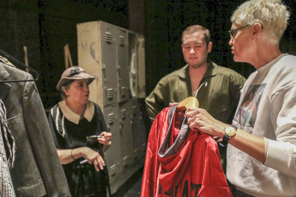 Susan Jackson coordinates actors backstage in Diego Rivera Theatre on Nov. 5.  (Photo by Natasha Dangond)