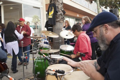 A music band 'Adelante' performs live salsa and Latin jazz for the audience in front of Mama' Art Cafe on Mission Street during Sunday Streets Festival in Excelsior, San Francisco on Sunday, Sept. 28, 2014 (Photo by Ekevara Kitpowsong)