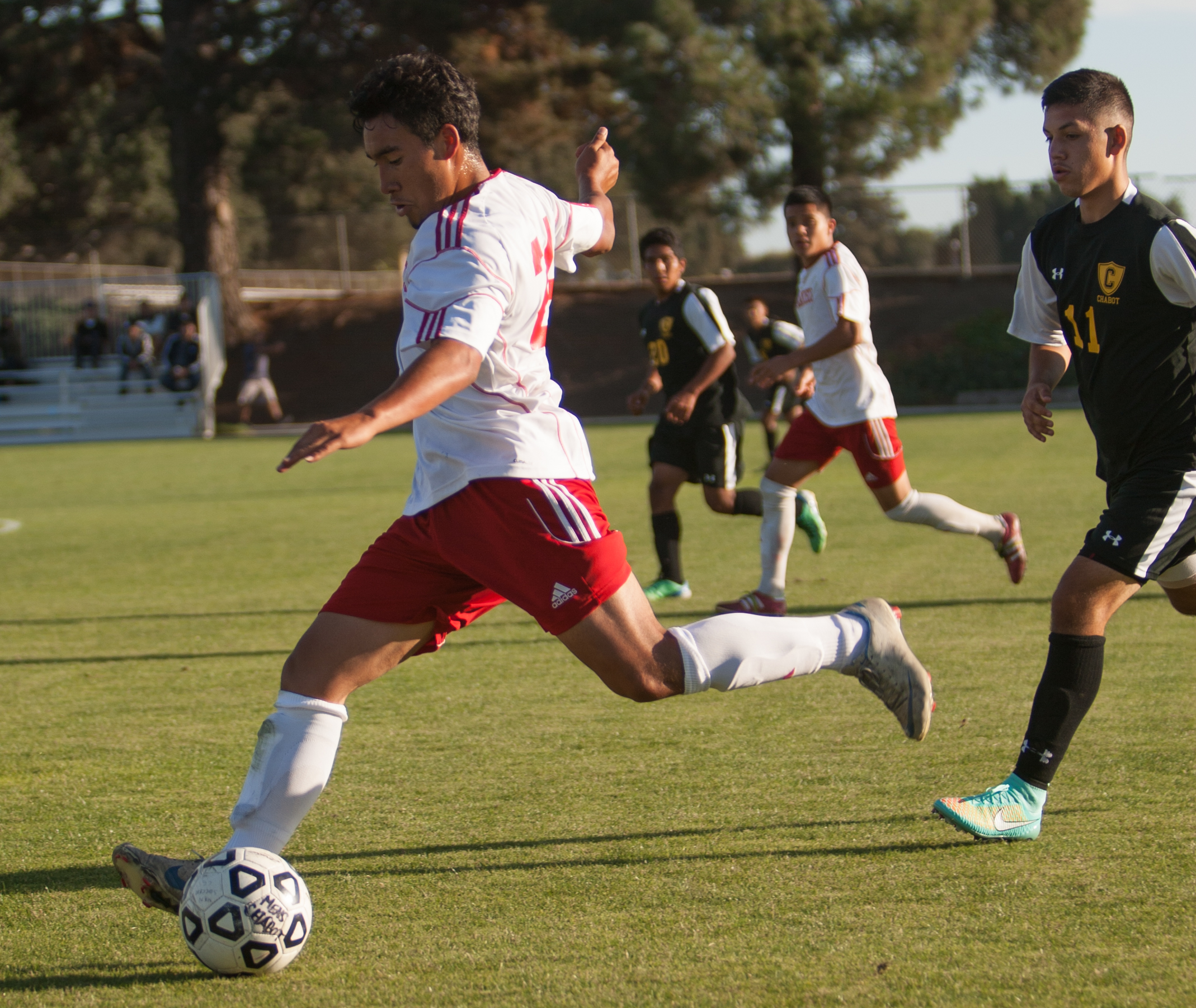 City College Rams soccer player strikes the ball. (Photo by Khaled Sayed)
