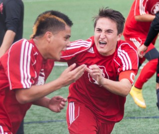 Andy Altamirano (left) celebrates with his teammate after he scores the game tying goal. (Santiago Mejia)