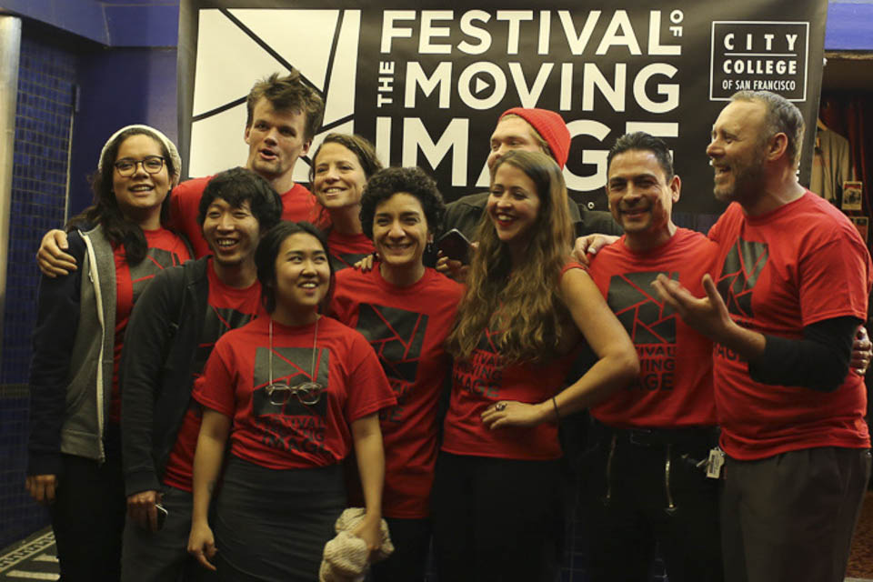 Festival of the Moving Image crew members gather in front of the theater.  (Photo by Natasha Dangond)