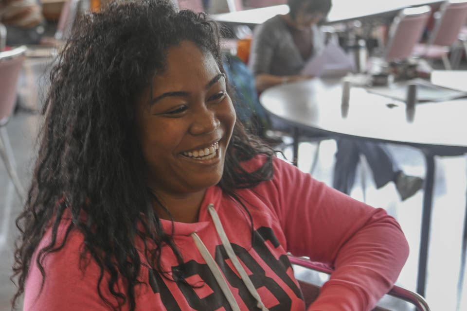 Carida Ward, a guardian scholar, laughs during a homework session, Oct. 10. (Photo by Natasha Dangond)