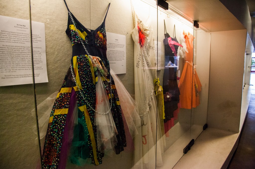 """Selections from Project SURVIVE's """"ReDressing Injustice"""" display on the Rosenberg Library's second floor. (Photo by Ekevara Kitpowsong)"""